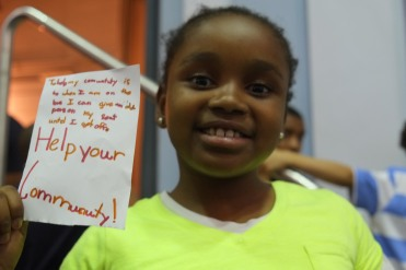 A student from Play Rugby USA pledges to help her community.